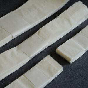 Pergamintaschen, Papierfalten, Archivierungsschachteln